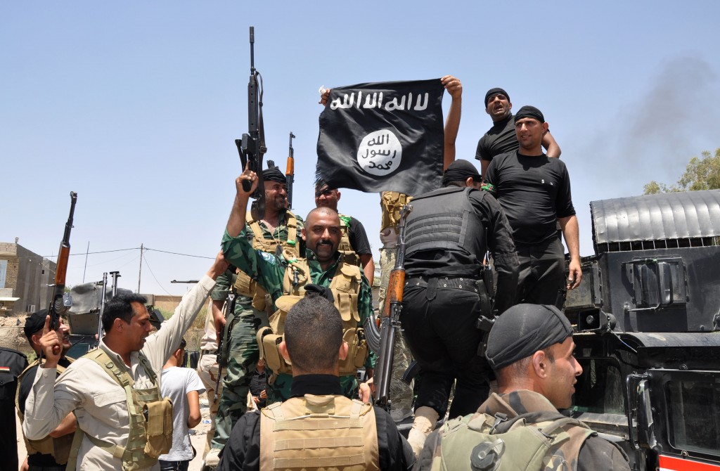 Miliziani dell'Isis in Iraq (AP Photo) - jihadisti al confine turco
