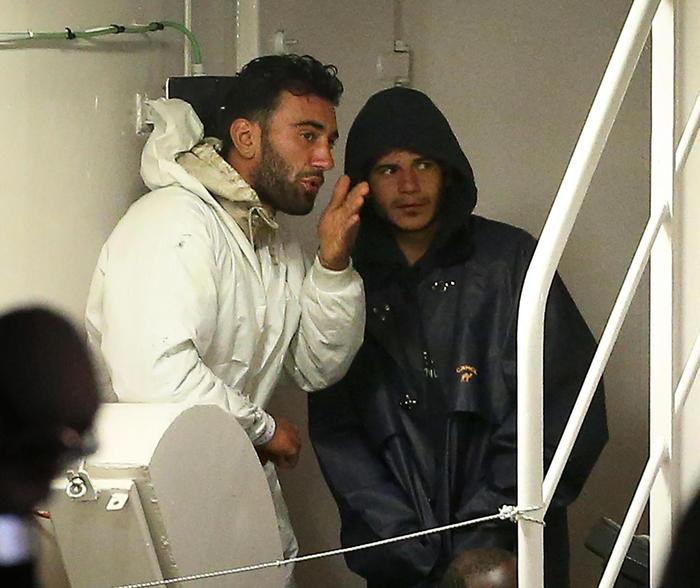 I presunti scafisti, riconosciuti da altri naufraghi testimoni, a bordo della nave Gregoretti nel porto di Catania