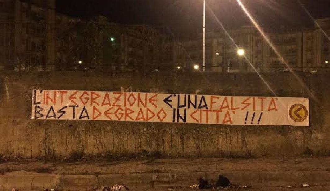 Lo Striscione di Azione Identitaria Calabria nel quartiere Ciampa a Lamezia integrazione rom fallita