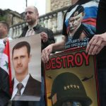 manifestanti siriani pro Assad