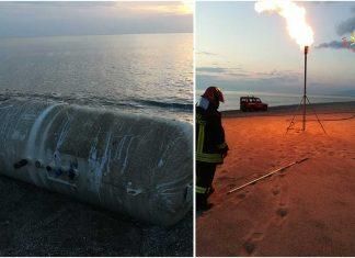 Torremezzo, bombolone di Gpl si arena sulla spiaggia. Messo in sicurezza